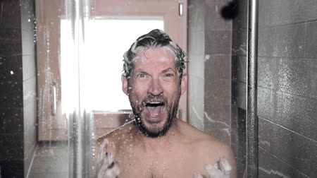 man desperate about loosing hair during a shower