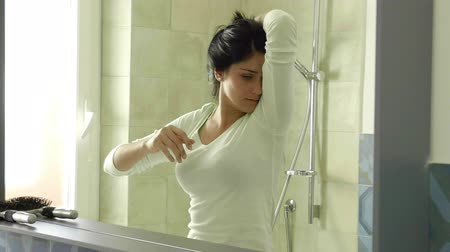 unpleasant smell : Woman screaming for stinky armpit slow motion in bathroom.mov Stock Footage
