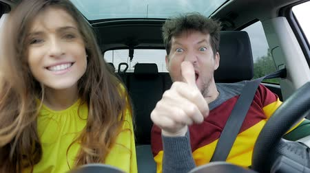 amalucado : cool happy couple dancing like crazy in car slow motion Stock Footage