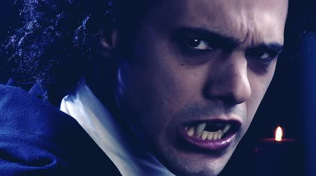 fantasia : Sad male vampire turning around looking camera angry slow motion dolly shot