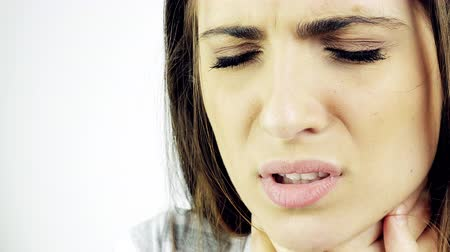 hrdlo : Woman feeling cold ill coughing isolated 4K closeup