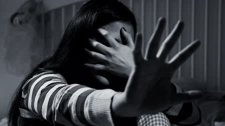 taciz : Woman at home scared shaking fear of domestic violence