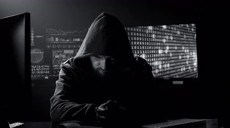 Portrait of hacker thinking black and white Stock Footage