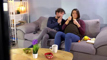 Funny man begging pregnant wife playing videogame console