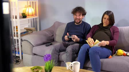 Pregnant woman desperate about husband addicted to videogames Stock Footage