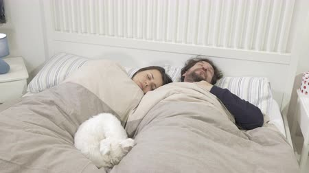 Sick couple in bed with headache and fever coughing in the morning Stock Footage