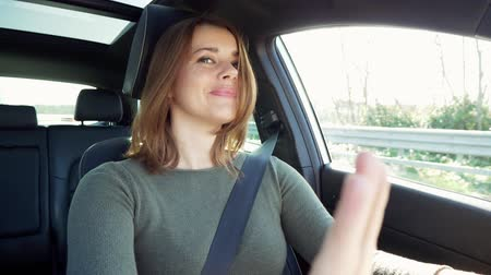 Beautiful woman enjoying trip with car driving happy listening to radio slow motion
