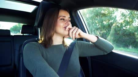 Beautiful woman driving car thinking about love smiling Stock Footage
