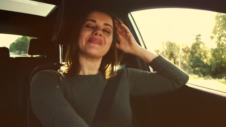 Gorgeous lady feeling happy in love driving car slow motion