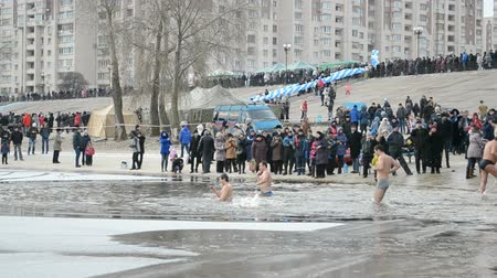 epiphany : Epiphany near Svjato-Pokrovskiy Cathedral on January 19,2014 in Kiev,Ukraine.People plunging into ice-cold water as it helps body became resilient to illness. Epiphany known since 988 AD. Stock Footage