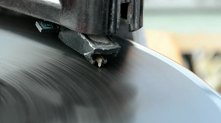gravar : vintage gramophone record player with stylus closeup and rotating disc, retro nostalgia