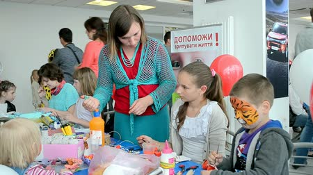 soft tip : International Childrens day. KIEV - MAY 31, 2014: NIKO Junior Fest 2014. Event organized by VAB leasing, NIKO-Ukraine (official dealer of Mitsubishi Motors in Kiev region).