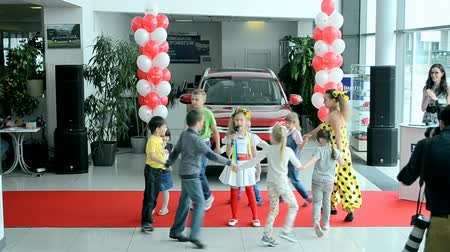 soft tip : KIEV-MAY 31,2014: kids dancing during NIKO Junior Fest 2014 devoted to International Childrens day. Event organized by VAB leasing, NIKO-Ukraine (official dealer of Mitsubishi Motors in Kiev region). Stock Footage