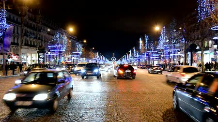 motorcar : Christmas illumination, car traffic on Avenue des Champs-Elysees in Paris in Paris, France on December 31, 2013.