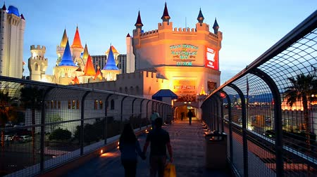 destaque : LAS VEGAS 6 - APR 03: Las Vegas Strip on April 03,2014 in Las Vegas, Nevada. Entrance to Excalibur tram. The strip has approximately 6.8 km(4.2 mi) long and featured with world class hotels and casinos.