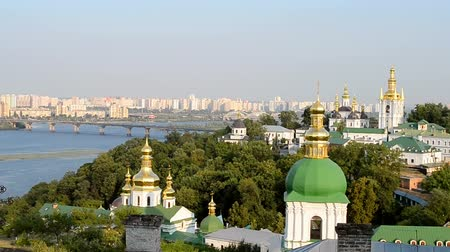 baptized : Kiev Pechersk Lavra, Dnieper river and bridge, Kiev summer landscape in sunny day Stock Footage