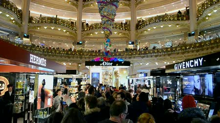lafayette : PARIS - DEC 30, 2014: Christmas decorated Galeries Lafayette department store on the Boulevard Haussmann on December 30, 2014 in Paris, France. Galeries Lafayette building was officially open in 1912.