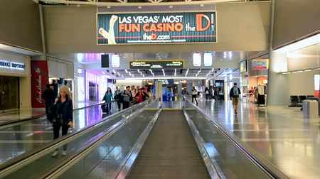 voyager : LAS VEGAS, NV - APRIL 13: McCarran international airport interior on April 13, 2016 in Las Vegas, USA. Airport was found in 1942 and now has more than 1234 slot machines inside the airport terminals. Stock Footage