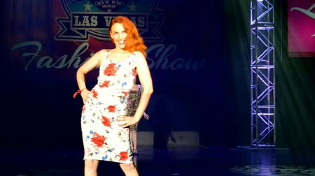 подиум : red hair female during Viva Las Vegas Fashion Show 2016 on April 15, 2016 in Las Vegas, USA. Viva Las Vegas Rockabilly Weekend take place on April 14-17, 2016.