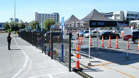 voyager : LAS VEGAS, NV - APR 19: UBER taxi station on April 19, 2016 in Las Vegas, USA. Uber Technologies Inc. is an American worldwide online transportation network company founded in March, 2009. Stock Footage