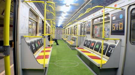 lugares sentados : Metro wagon designed with stadium style during UEFA Champions League Final 2018 on May 23, 2018 in Kiev, Ukraine. FC Real Madrid and FC Liverpool Final game take place on May 26, 2018.
