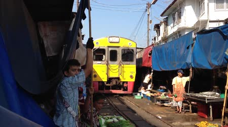 maeklong : Train going through a Thai Market Stock Footage