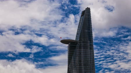 uzun boylu : Skyscraper in Saigon - Cloudscape in background Stok Video