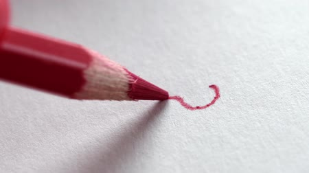 noktalama : red pencil drawing a question mark on a white Notepad