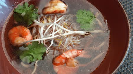 vápenné mléko : soup with seafood and soy sprouts in the restaurant