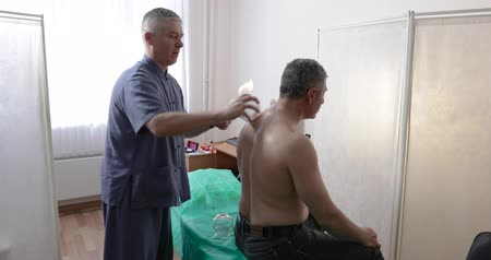 suction cups : the doctor treats the man of the patient with Chinese medicine Stock Footage