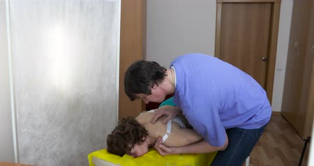 akupresura : osteopath massaging a woman shoulder Concept of people and professions, types of restorative massages, removal of fatigue