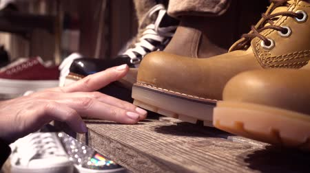 fashion outlet : selection of shoes in the store by the hands of the buyer