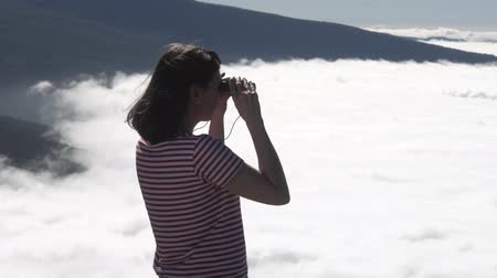 kanarya : girl looking through binoculars on the hill with views of Teide.Tenerife