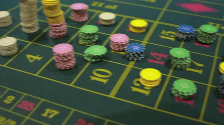 croupier : croupier and casino players and chips. casino gaming table. Full HD. Moving the camera on a tripod