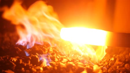 historical building : Hot Metal and Burning Fire in a Blacksmith Forge Stock Footage