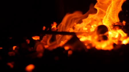 forging sword : Piling Up Burning Coals in a Hot Forge