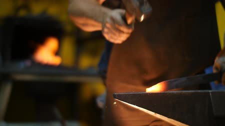 forging sword : Blacksmith Forging a Sword in a Workshop on an Anvil Slow Motion
