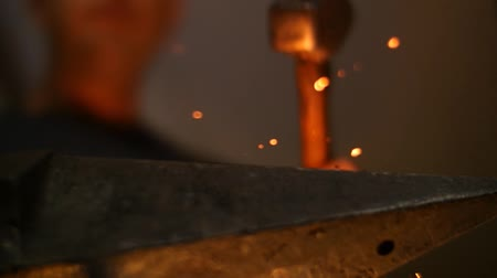 forging sword : Blacksmith Forging Sword on an Anvil with a HammeLow Angle Slow Motion Stock Footage