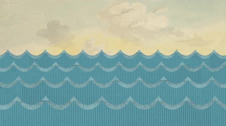 water puppet : Theatrical Windy Cardboard Sea Waves on a Painted Cloudy Sky Background