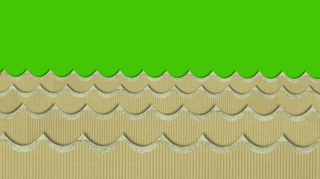 water puppet : Theatrical Cardboard Texture Sea Waves Moving on a Green Screen Background