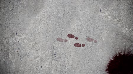 лечит : Murderer Foot Steps Walking Away From Crime Scene Стоковые видеозаписи