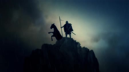 miecz : A Warrior and his Horse Standing on a Cliff Under a Lightning Storm