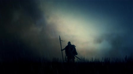 středověký : A Warrior Standing Alone in a Field Under Storm