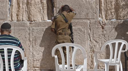 idf : Israeli Soldier Praying at the Western Wall in Jerusalem Israel