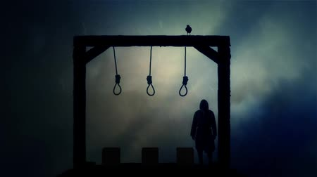 until : Executioner Standing in the Gallows Under a Storm