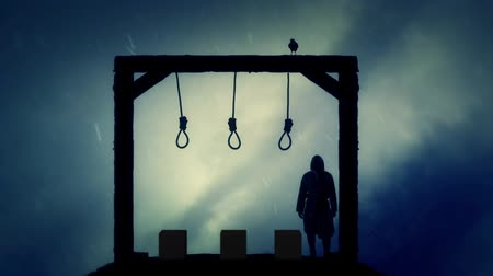until : Executioner Standing in the Gallows Under Rain Stock Footage