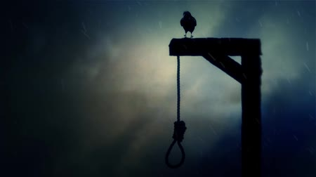trest : Raven Standing on a Gallows with a Swinging Noose in a Storm