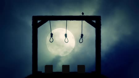 trest : Nooses Hanging on the Gallows with a Raven on a Full Moon Spooky Night