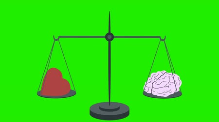 felsefe : Brain Vs Heart on Scales on a Green Screen