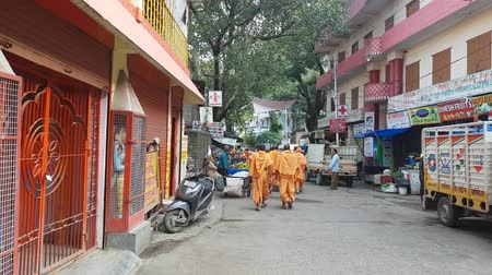 puja : Monks with Saffron Robes in Durga Puja Rishikesh